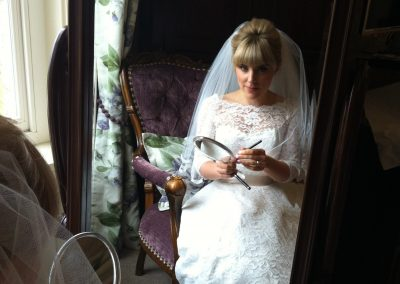 Bride sitting wearing dress