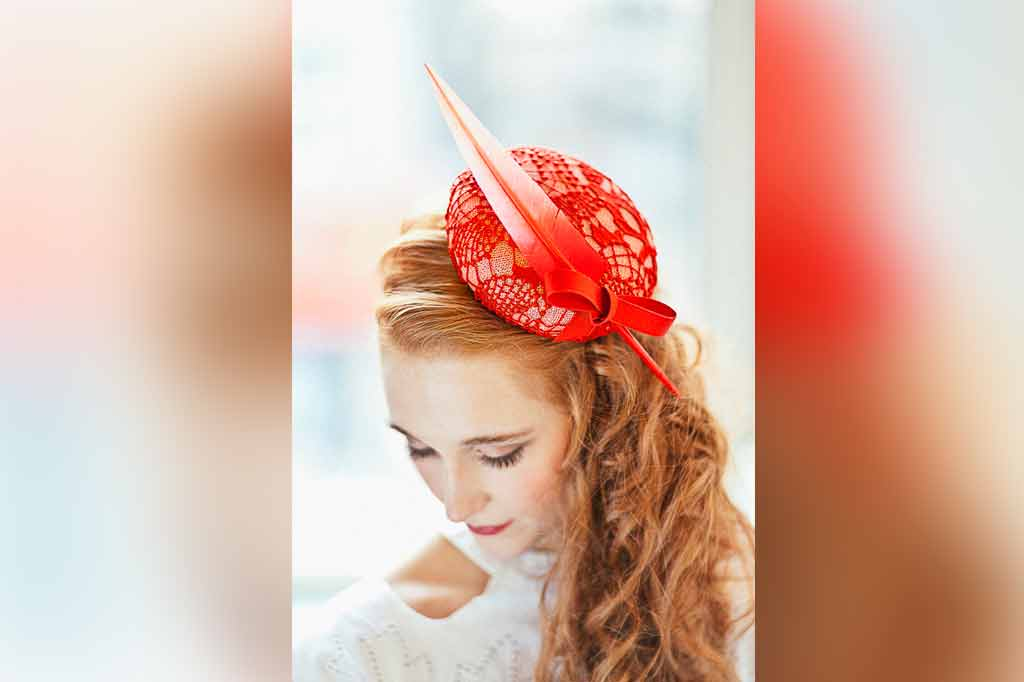 red haired woman wearing hat