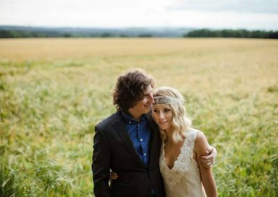 couple walking in field-rustic-wedding-gallery-hair-edinburgh-hairdressers