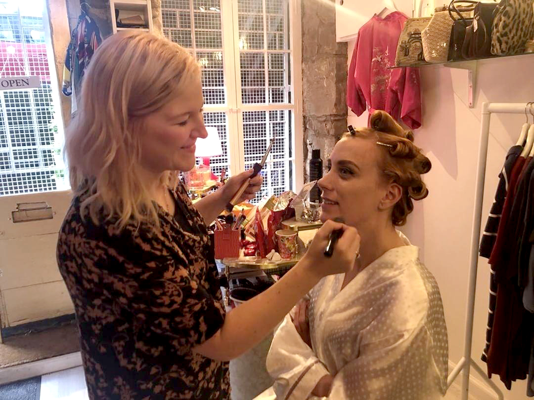 applying makeup backstage