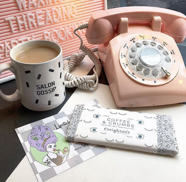 Retro pink telephone and a cuppa
